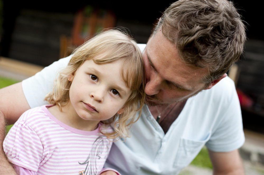 Outdoor portrait of father with his little daughter