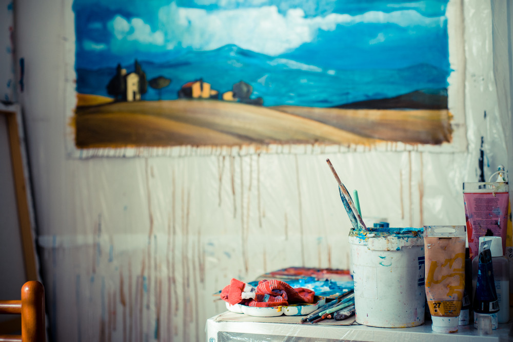 painter studio with paint and brushes particular
