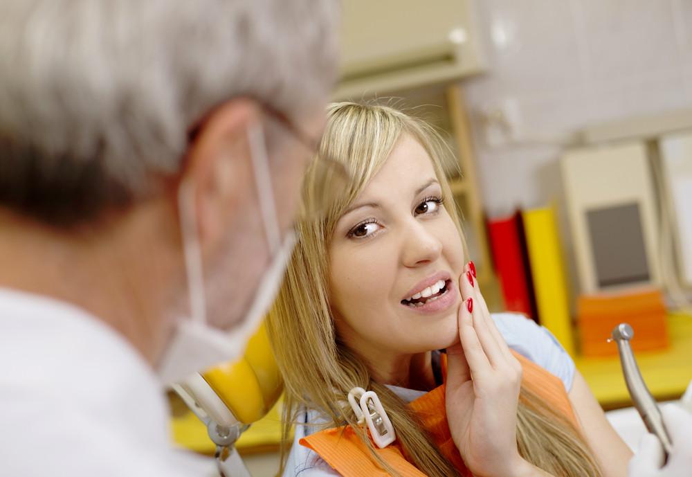 Patient is having a dental treatment