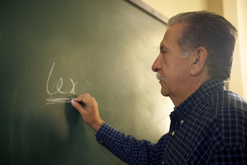 People and education, professor writing on board during lesson in college, Law School, University of Havana, Cuba