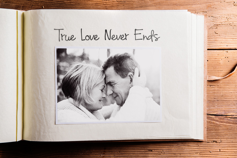 Photo album with black-and-white picture of senior couple in love ...