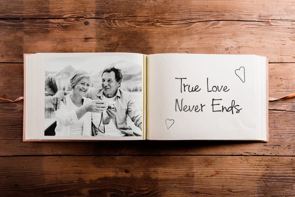 Photo Album With Black And White Picture Of Senior Couple On