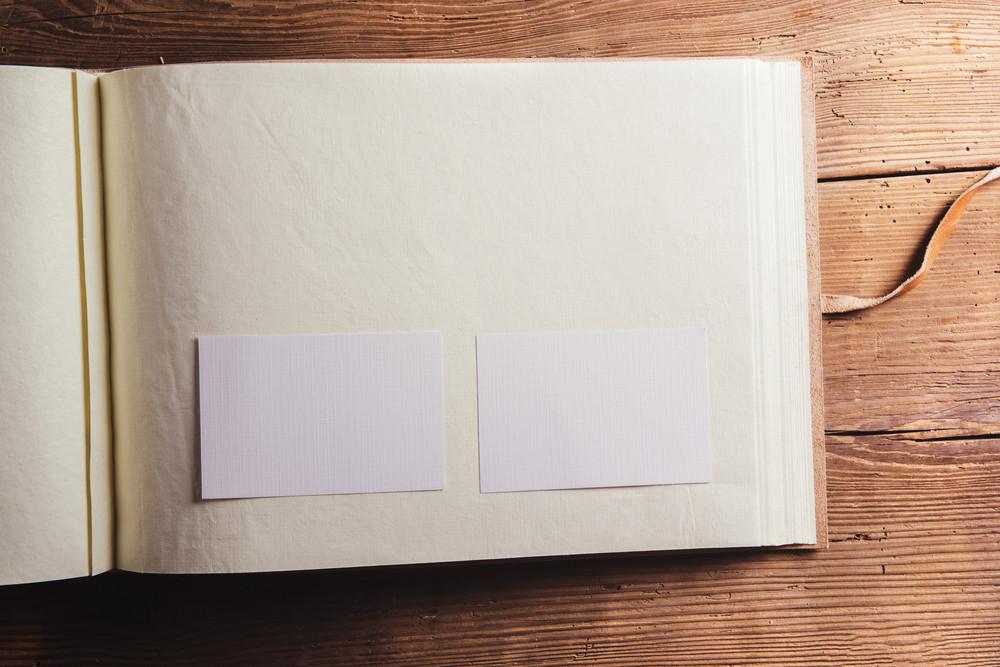 Photo album with empty space. Studio shot on wooden background.