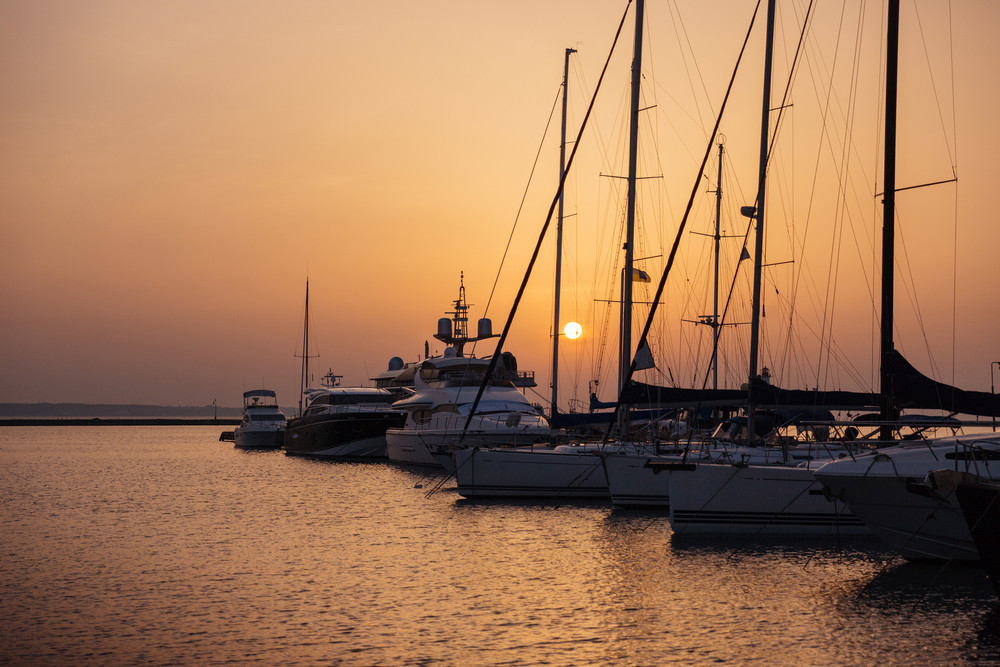 Photo of pier with boats. sunset