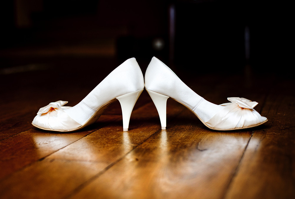 Photograph of a beautiful wedding shoes ready for bride