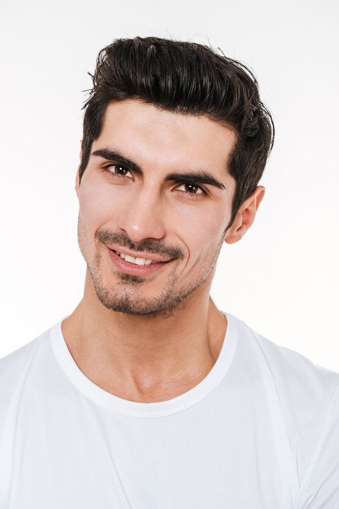 Picture of happy cheerful young bristle man standing over white background.