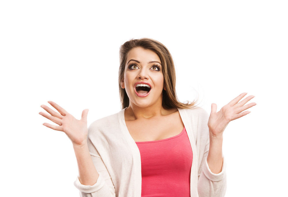 Portrait Of A Surprised Woman Isolated On White Background