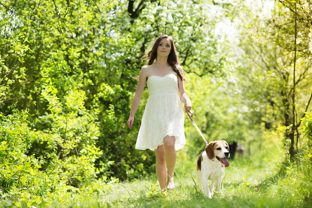 Portrait of a woman with her beautiful dog outdoors