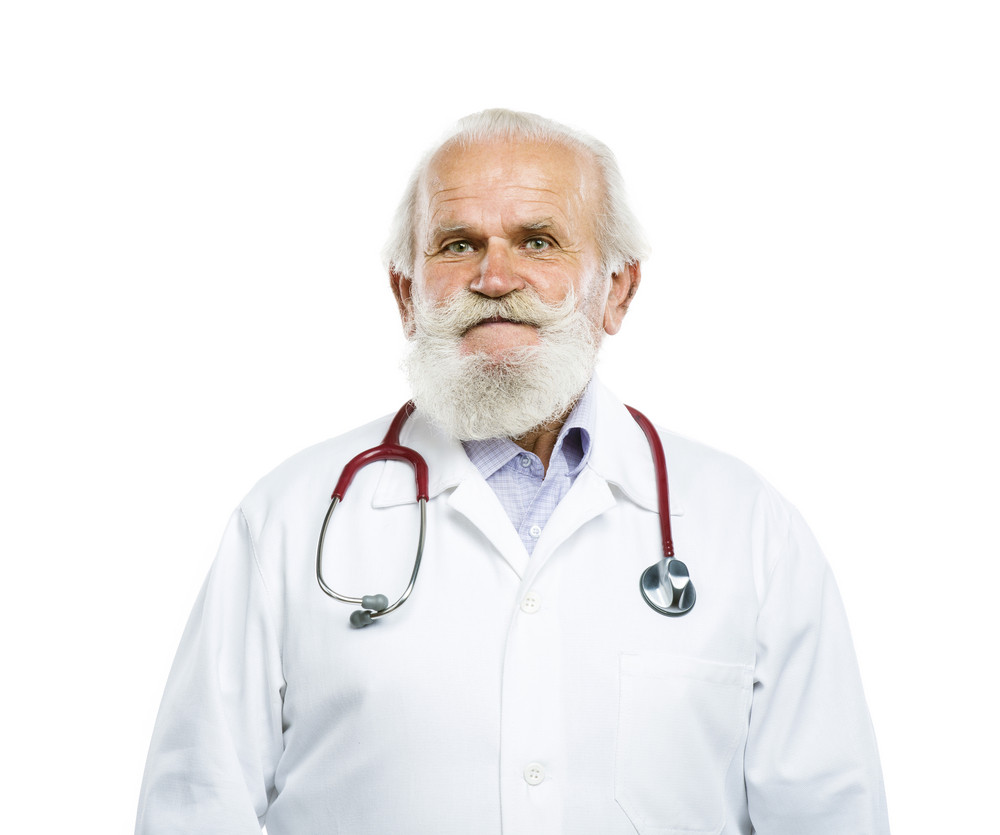 Portrait of an old male doctor with a stethoscope around his neck isolated on white background