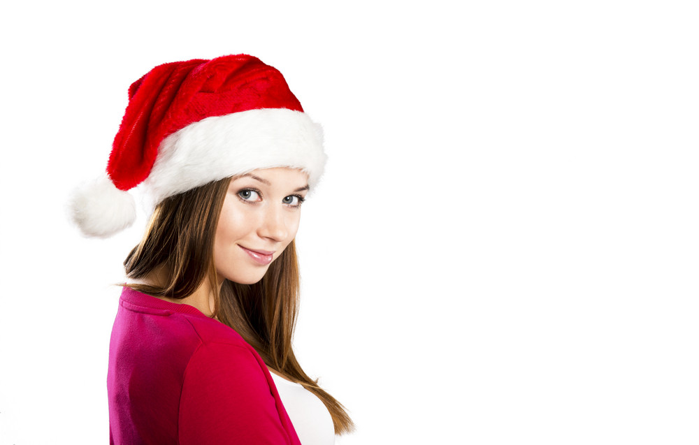 Portrait of attractive woman isolated on white, studio shot in christmas hat