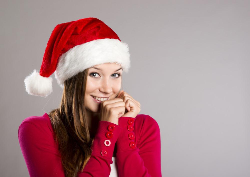Portrait of attractive woman, studio shot in christmas hat
