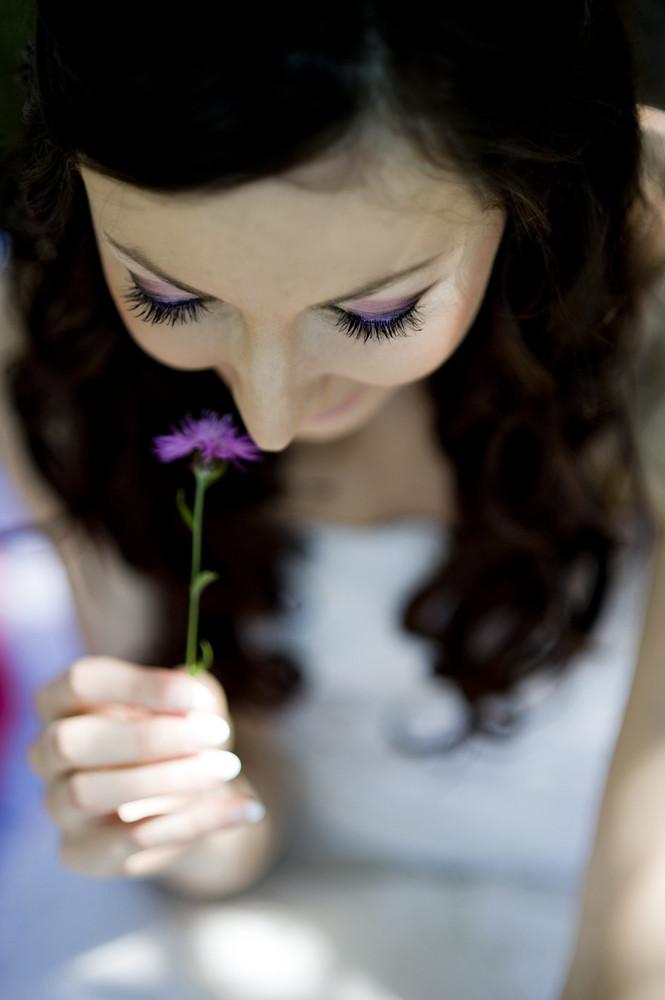 Portrait of beautiful brunette bride with flower