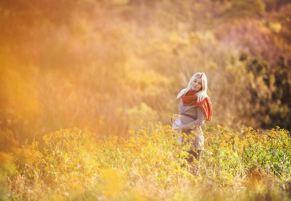 Portrait of beautiful pregnant woman in a field