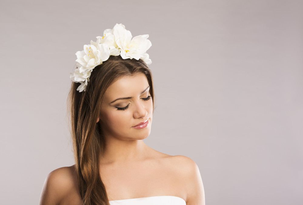 Portrait of beautiful woman with white flower in her hair isolate portrait of beautiful woman with white flower in her hair isolate on grey background mightylinksfo