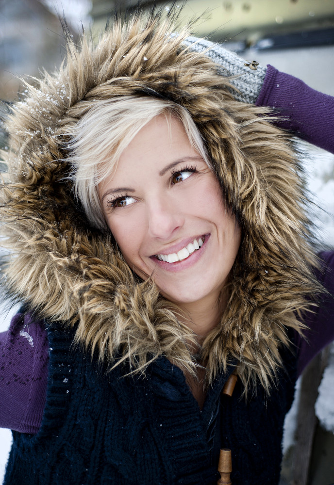 Portrait of blonde woman in snow country
