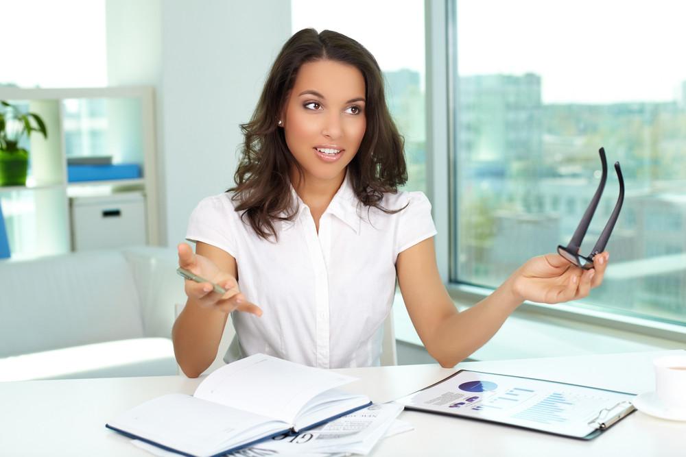Portrait of businesswoman explaining her idea in office