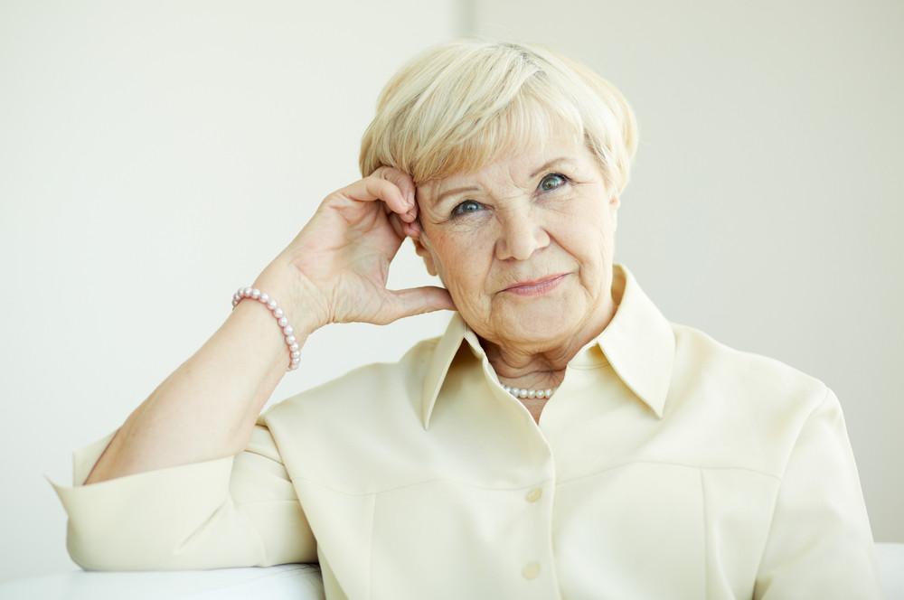 Portrait of elderly female looking at camera