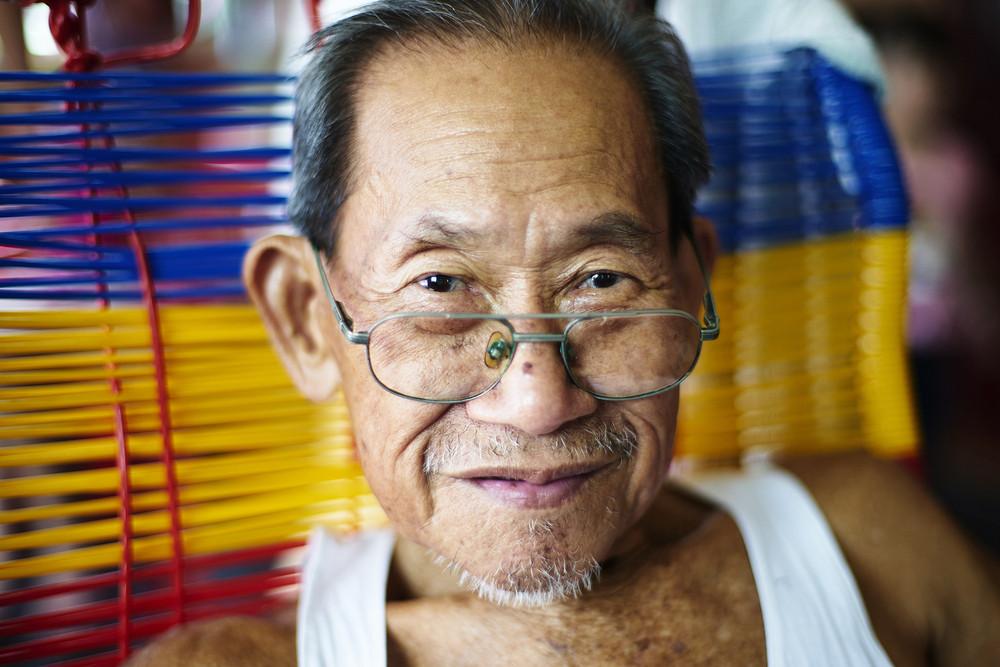 Portrait of happy senior asian man
