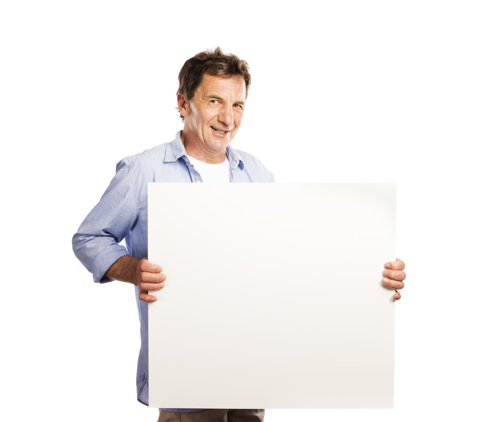 Portrait of happy senior man with blank advertising board or copy space, isolated on white