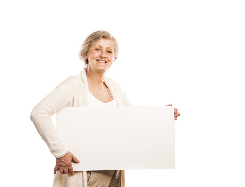 Portrait of happy senior woman with blank advertising board or copy space, isolated on white