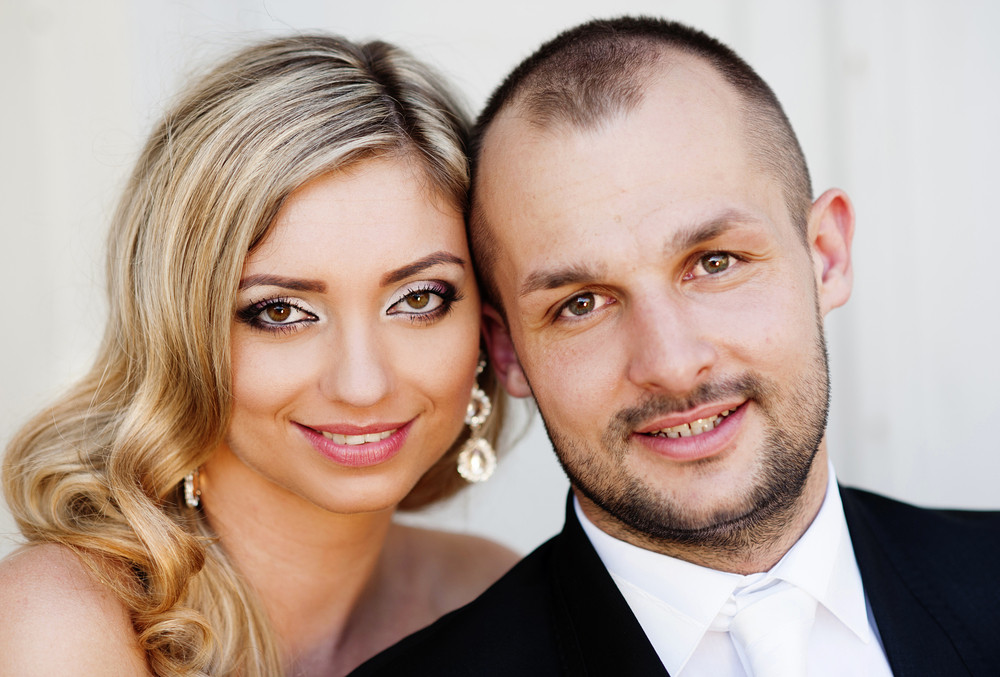 Portrait of happy young bride and groom on their wedding day