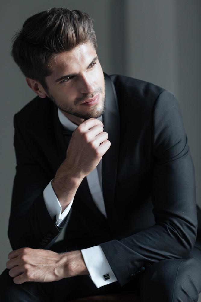 Portrait of model in suit. looking away