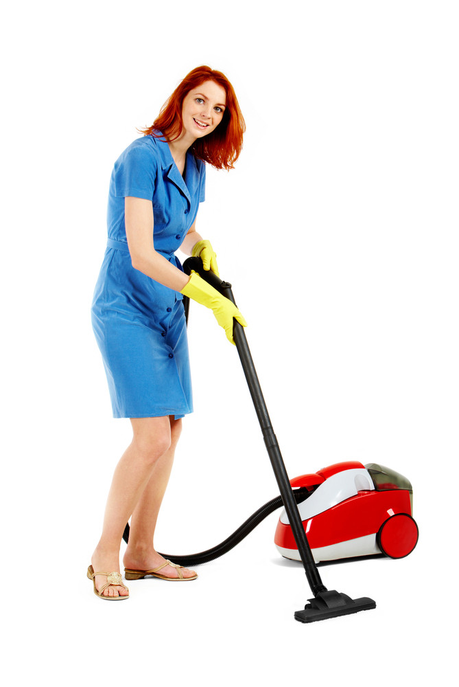 Portrait of nice housewife doing housework with vacuum cleaner