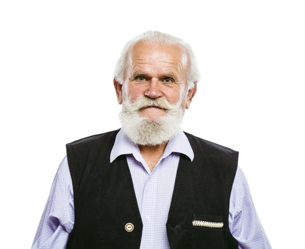 Portrait of old bearded man, posing in studio on white background