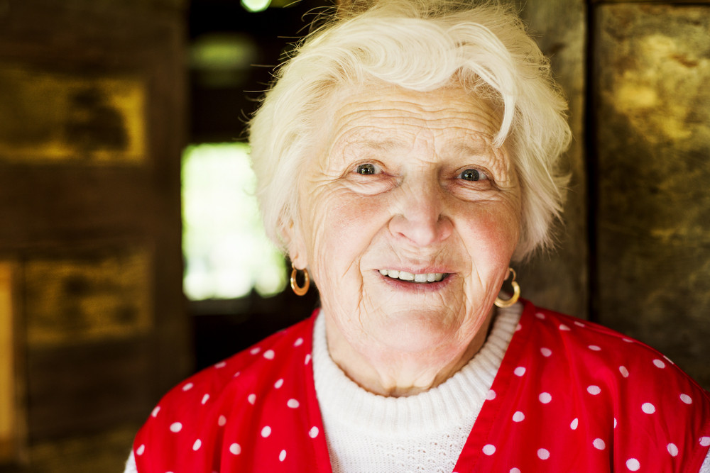 Portrait of smiling old woman at home