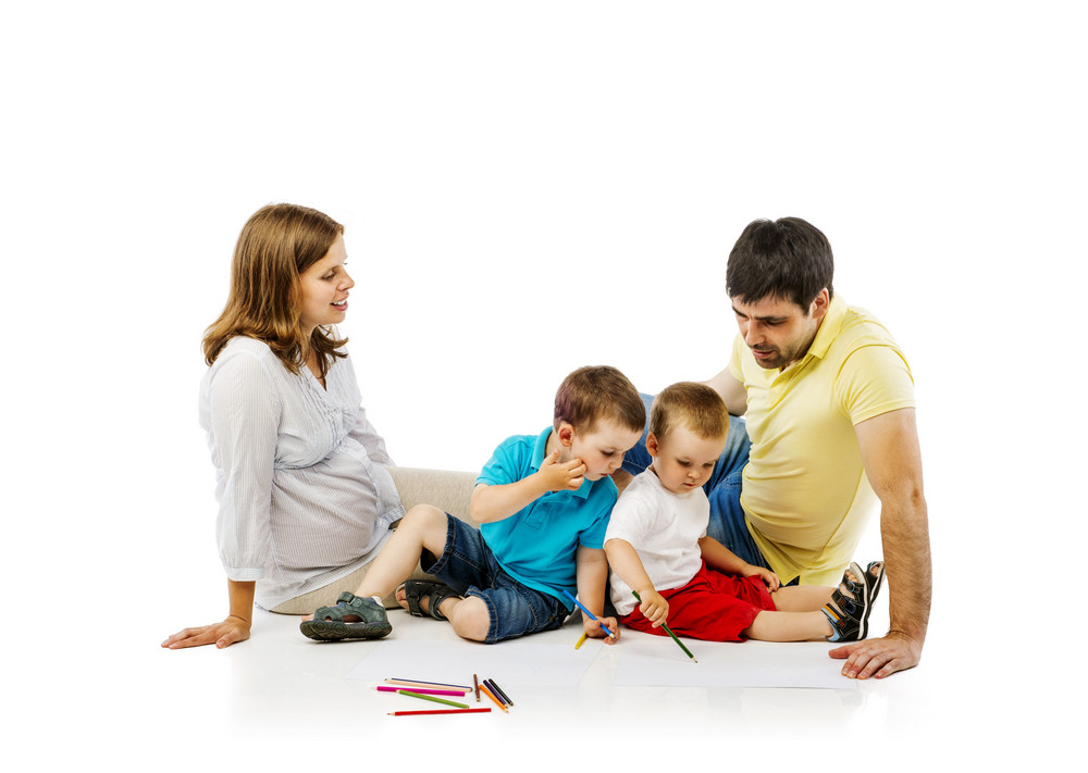 Portrait of the happy family with two children and pregnant mother drawing, isolated on white background