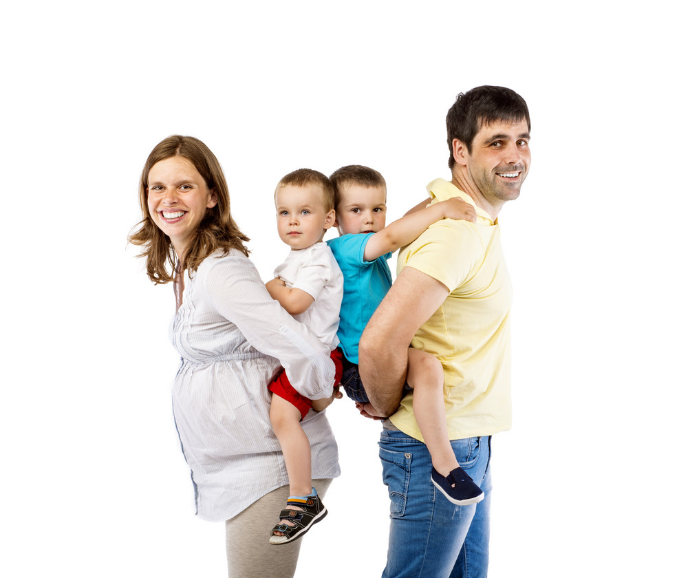 Portrait of the happy family with two children and pregnant mother, isolated on white background