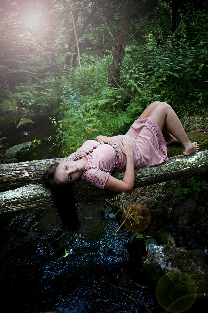Portrait of young pregnant woman in nature