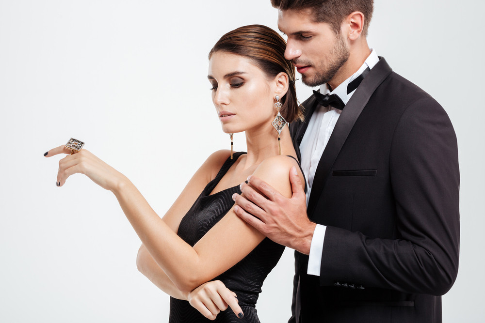 Pretty business couple. guy hugging woman from behind