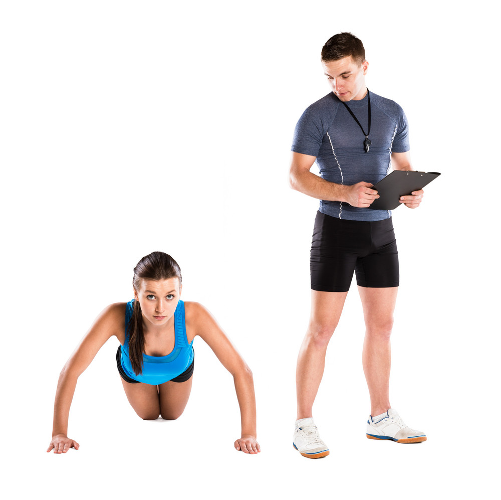 Professional fitness coach with beautiful young woman on white background