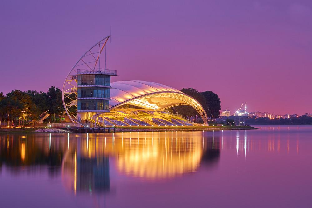 PUTRAJAYA, MALAYSIA - January 02, 2016 : Water Sport Center, located at Putrajaya, Malaysia, captured in beautiful night scene with purple sky.
