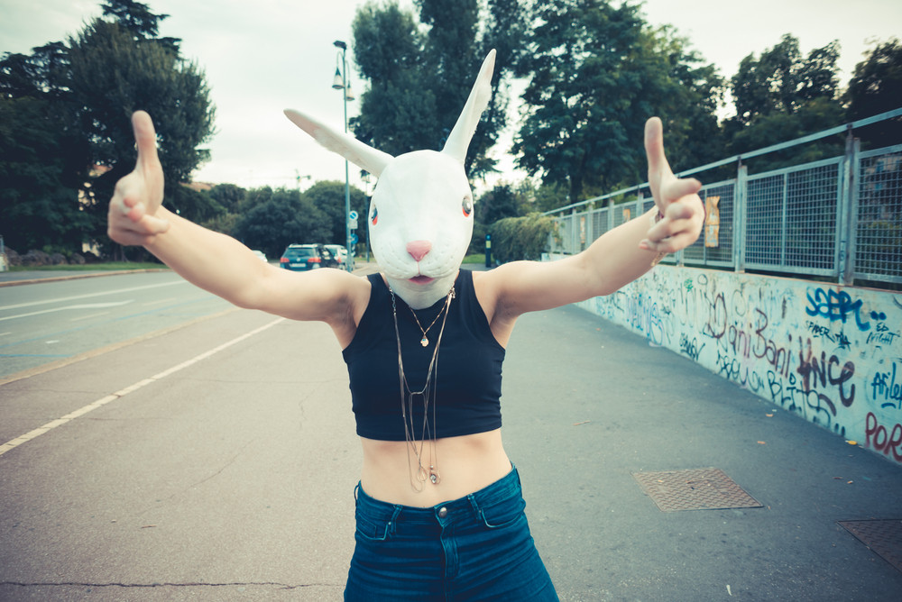rabbit mask woman abusrd unreal in the city