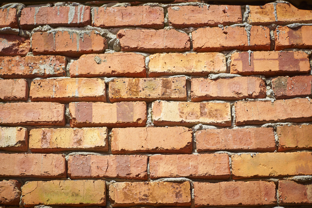 Raw red brick wall