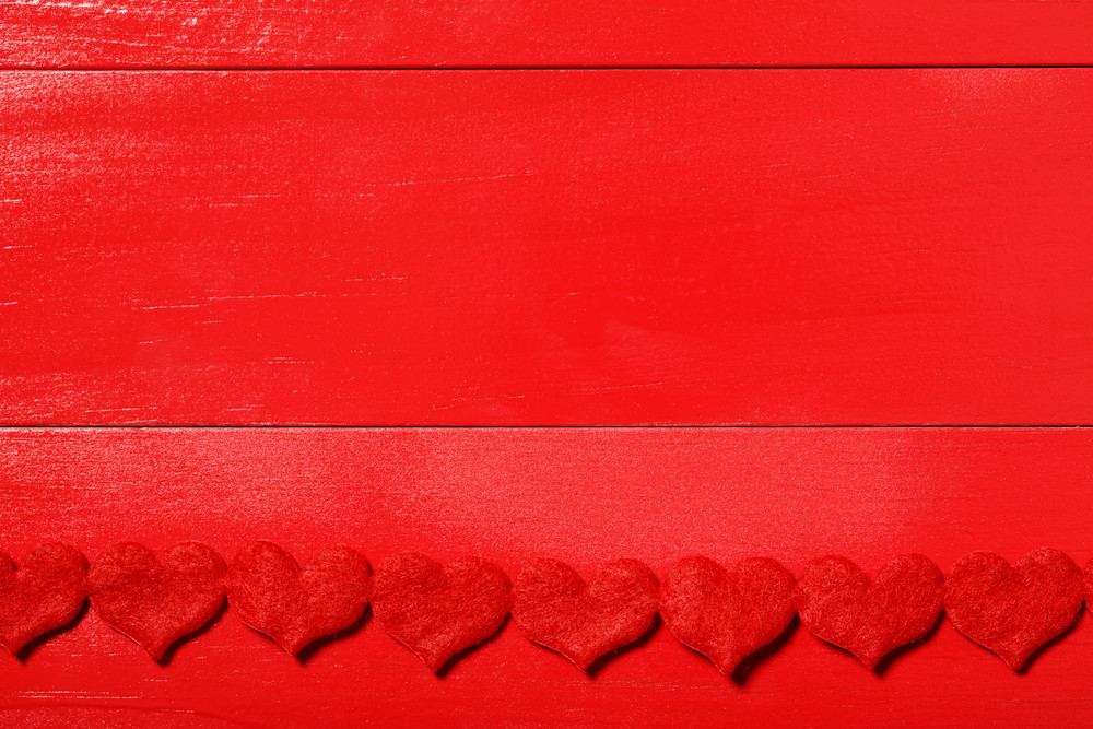 Red wood and red felt hearts valentine's day background