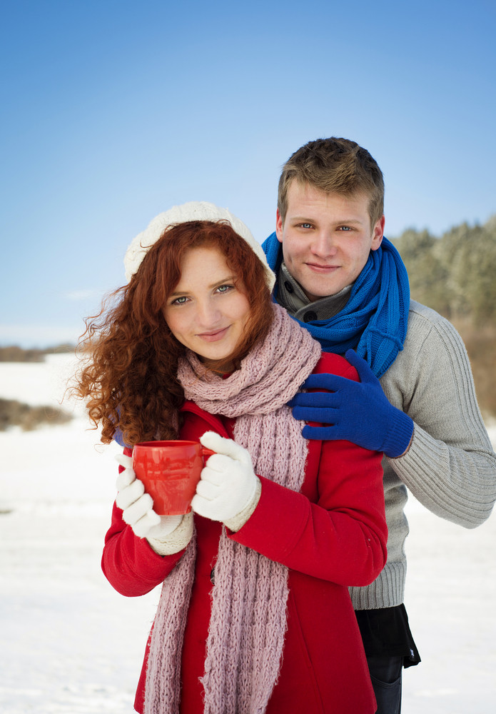 Romantic snow portraits in the nature with beautiful couple