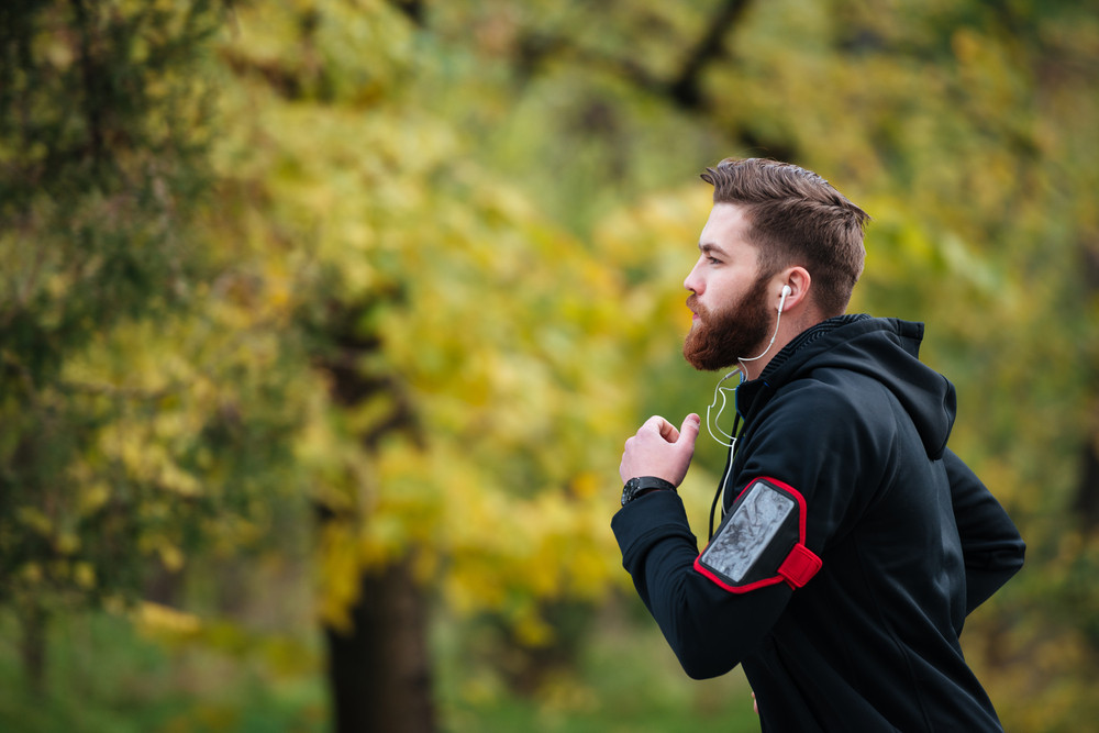 Runner in park. in profile. fashion photo