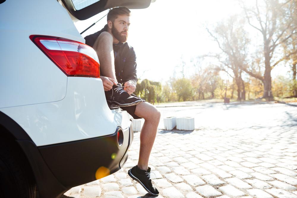 Runner preparing in car. side view