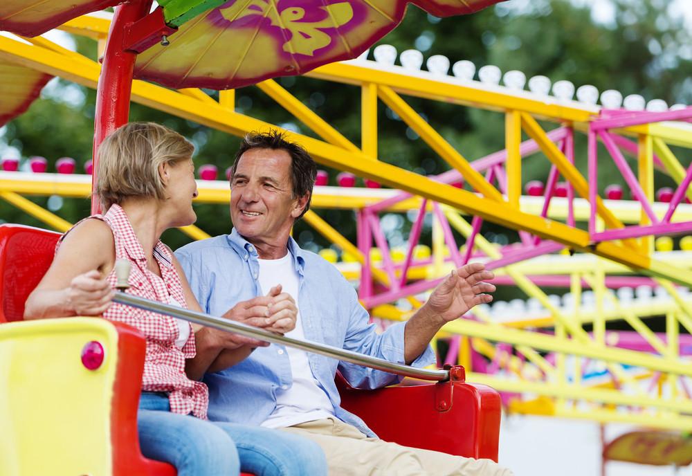 Senior couple having fun in amusement park