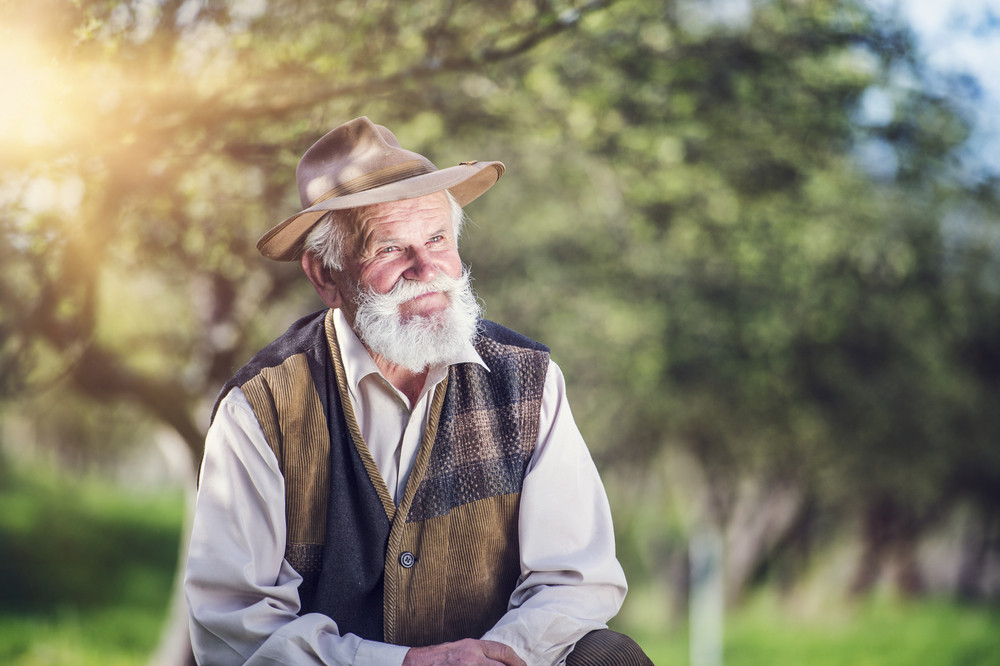 Senior farmer outside in beautiful summer nature