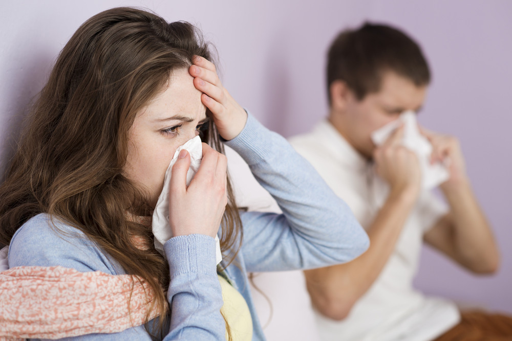 Sick woman and man have cold, flu and high fever.
