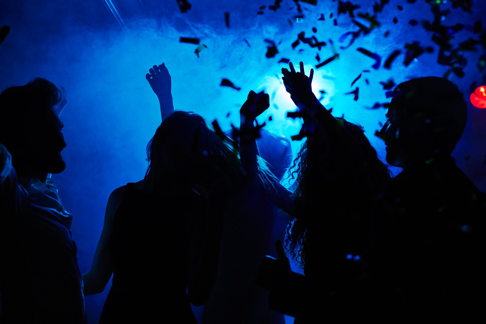 Silhouettes of people clubbing at night