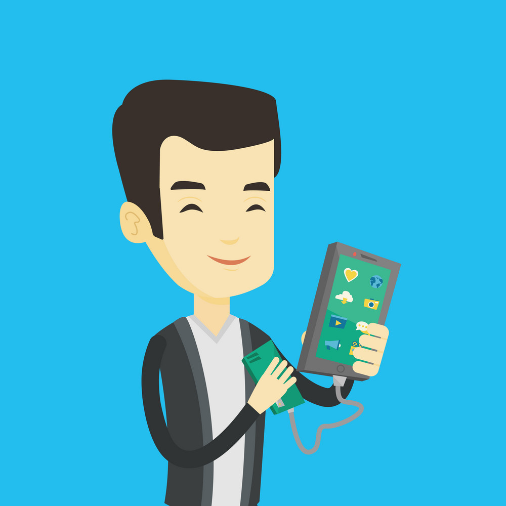 Smiling asian man recharging his smartphone with mobile phone portable battery. Young man holding a mobile phone and battery power bank. Vector flat design illustration. Square layout.