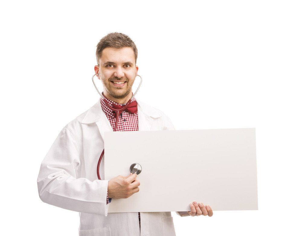 Smiling medical doctor man with stethoscope. Isolated on white background.