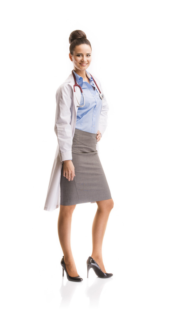 Smiling medical doctor woman with stethoscope. Isolated on white background.