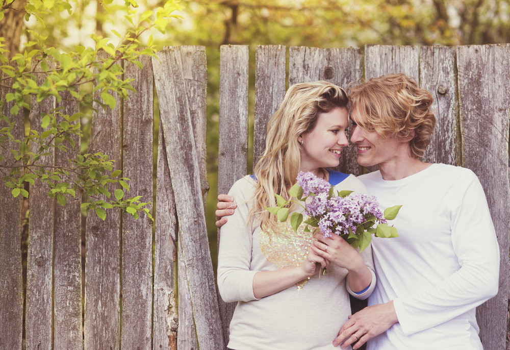 Spring outdoor portrait of young happy couple