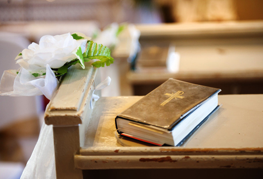 Still photo of bible put on wooden desk in church